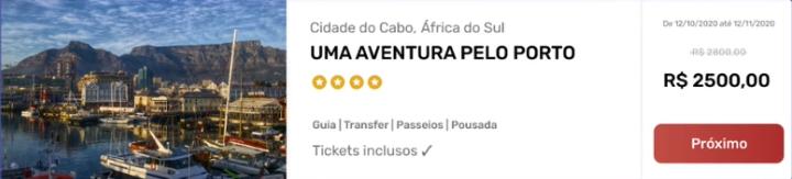 """área de venda de pacotes. Contém uma imagem de um porto,  o título """"Aventura no Porto, cidade do Cabo África do Sul"""". Há um grupo de ícones com cinco estrelas baixo do título. Teremos ainda o conjunto de palavras """"Guia, transfer, passeios, pousada"""" e logo em seguida a frase """"Tickets Inclusos"""", o valor antigo do pacote (2.800)riscado e o novo valor (2.500) em destaque. Por fim, o botão """"Próximo""""."""