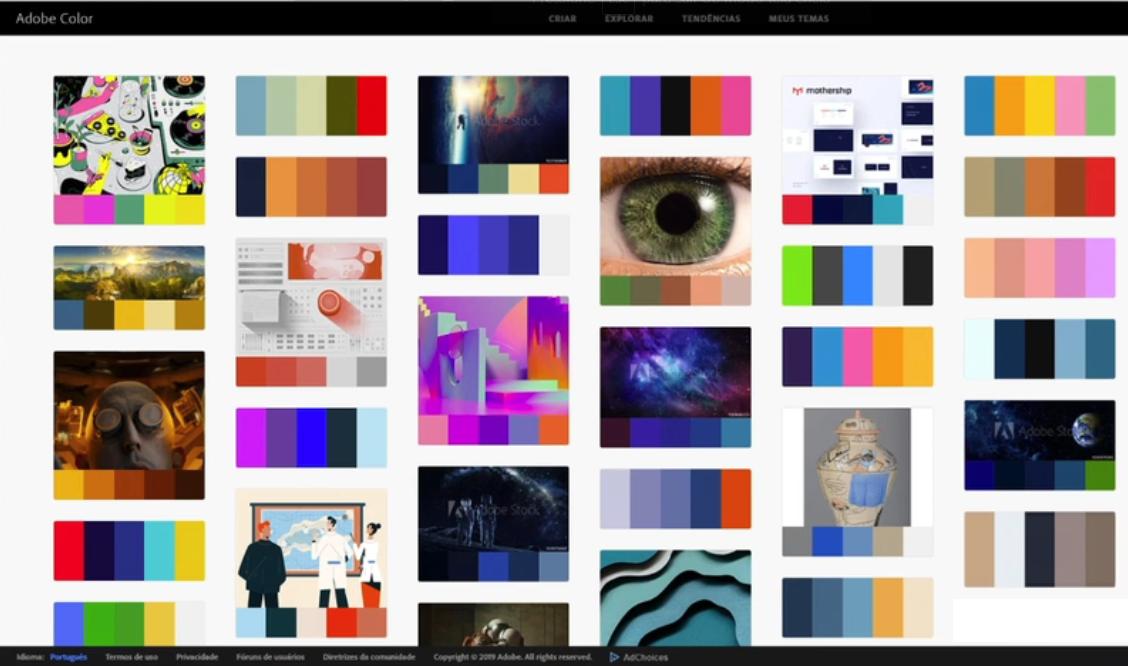 """Interface do site do Adobe Color aberto com o resultado da busca """"space"""" contendo vários exemplos de imagens com suas respectivas paletas de cor."""